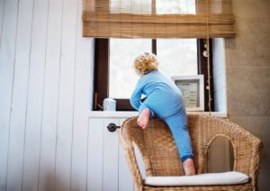 Baby crawling on precarious windowsill