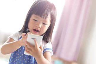 small child using phone