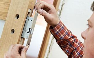 installing door lock strike plate