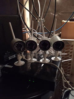 Four WiFi cameras as close to the router as possible.