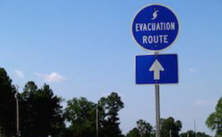 Emergency evacuation sign on the road