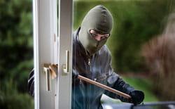 Burglar Breaking into Home with crowbar