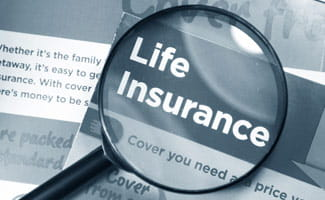 Life Insurance Document with Magnifying Glass