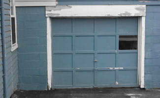 Old Garage Door That is Not Secured