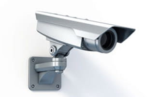 Outdoor security camera on wall