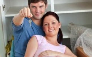 Expecting parents with key to new home