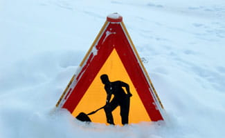 Sign burried in snow