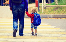 father walking with child