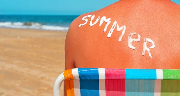 Sunscreen on back spelling the word summer