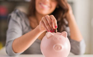 Putting Money in a Piggybank for Savings